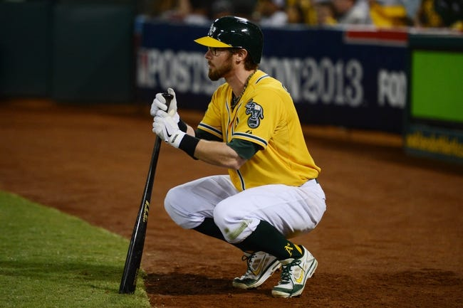 October 5, 2013; Oakland, CA, USA; Oakland Athletics second baseman Eric Sogard (28) stretches on deck during the seventh inning in game two of the American League divisional series playoff baseball game against the Detroit Tigers at O.co Coliseum. The Oakland Athletics defeated the Detroit Tigers 1-0. Mandatory Credit: Kyle Terada-USA TODAY Sports