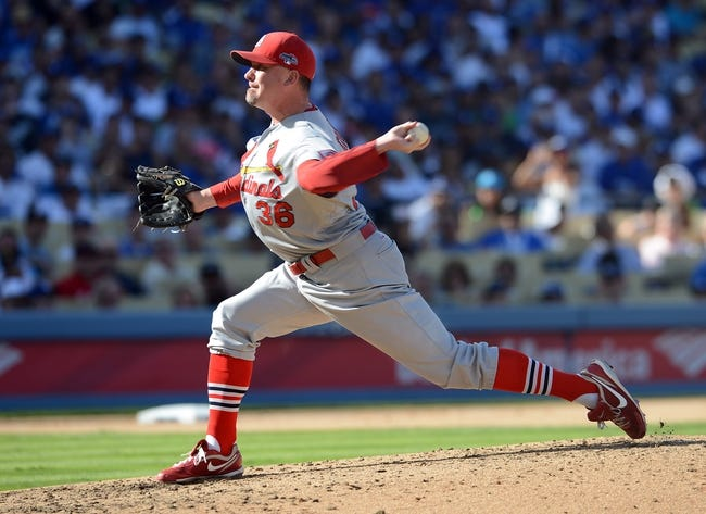 October 16, 2013; Los Angeles, CA, USA; St. Louis Cardinals relief pitcher Randy Choate (36) pitches the sixth inning against the Los Angeles Dodgers in game five of the National League Championship Series baseball game at Dodger Stadium. Mandatory Credit: Jayne Kamin-Oncea-USA TODAY Sports