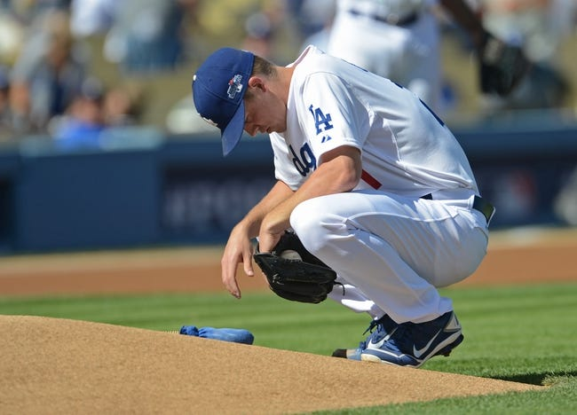 October 16, 2013; Los Angeles, CA, USA; Los Angeles Dodgers starting pitcher Zack Greinke (21) takes a moment at the mound during  game five of the National League Championship Series baseball game against the St. Louis Cardinals at Dodger Stadium. Mandatory Credit: Jayne Kamin-Oncea-USA TODAY Sports
