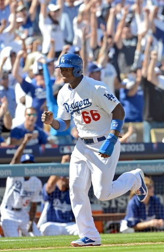 October 16, 2013; Los Angeles, CA, USA;  Los Angeles Dodgers right fielder Yasiel Puig (66) scores a run during game five of the National League Championship Series against the St. Louis Cardinals at Dodger Stadium. Mandatory Credit: Jayne Kamin-Oncea-USA TODAY Sports