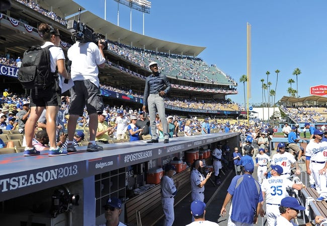 October 16, 2013; Los Angeles, CA, USA; Recording artist Aloe Blacc stands and sings on top of the dugout before the game between the Los Angeles Dodgers and the St. Louis Cardinals in game five of the National League Championship Series baseball game at Dodger Stadium. Mandatory Credit: Jayne Kamin-Oncea-USA TODAY Sports