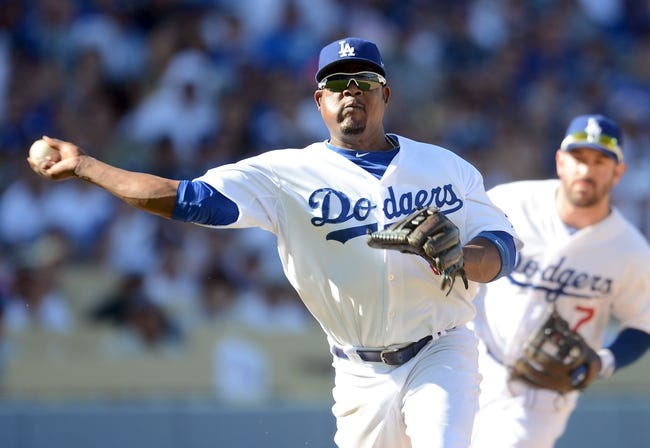 October 16, 2013; Los Angeles, CA, USA;  Los Angeles Dodgers third baseman Juan Uribe (5) during game five of the National League Championship Series against the St. Louis Cardinals at Dodger Stadium. Mandatory Credit: Jayne Kamin-Oncea-USA TODAY Sports