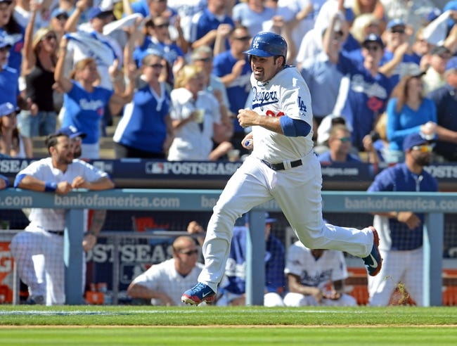 October 16, 2013; Los Angeles, CA, USA;  Los Angeles Dodgers first baseman Adrian Gonzalez (23) scores a run during game five of the National League Championship Series against the St. Louis Cardinals at Dodger Stadium. Mandatory Credit: Jayne Kamin-Oncea-USA TODAY Sports