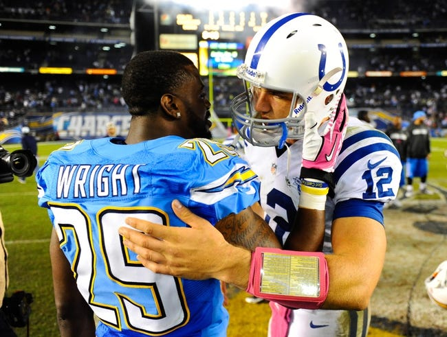 Oct 14, 2013; San Diego, CA, USA; Indianapolis Colts quarterback Andrew Luck (12) and San Diego Chargers cornerback Shareece Wright (29) after a Chargers win at Qualcomm Stadium. The Chargers won 19-9. Mandatory Credit: Christopher Hanewinckel-USA TODAY Sports