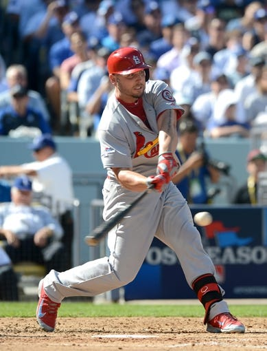 October 16, 2013; Los Angeles, CA, USA; St. Louis Cardinals left fielder Matt Holliday (7) at bat during game five of the National League Championship Series against the Los Angeles Dodgers at Dodger Stadium. Mandatory Credit: Jayne Kamin-Oncea-USA TODAY Sports