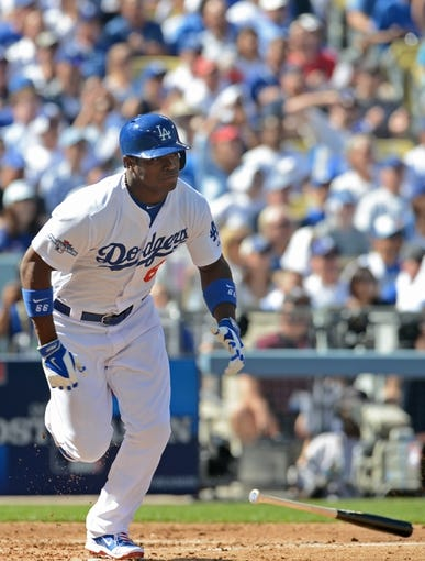 October 16, 2013; Los Angeles, CA, USA;  Los Angeles Dodgers right fielder Yasiel Puig (66) at bat during game five of the National League Championship Series against the St. Louis Cardinals at Dodger Stadium. Mandatory Credit: Jayne Kamin-Oncea-USA TODAY Sports