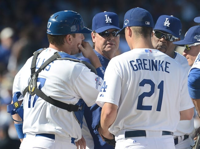 October 16, 2013; Los Angeles, CA, USA; Los Angeles Dodgers catcher A.J. Ellis (17), starting pitcher Zack Greinke (21) and coach Rick Honeycutt (44) at the mound during  game five of the National League Championship Series baseball game against the St. Louis Cardinals at Dodger Stadium. Mandatory Credit: Jayne Kamin-Oncea-USA TODAY Sports