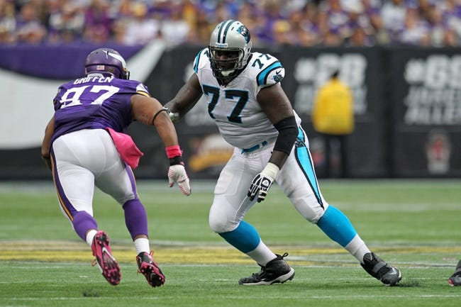 Oct 13, 2013; Minneapolis, MN, USA; Carolina Panthers offensive tackle Byron Bell (77) against the Minnesota Vikings at Mall of America Field at H.H.H. Metrodome. The Panthers defeated the Vikings 35-10. Mandatory Credit: Brace Hemmelgarn-USA TODAY Sports