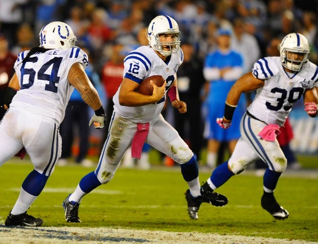 Oct 14, 2013; San Diego, CA, USA; Indianapolis Colts quarterback Andrew Luck (12) runs for a short gain during the second half against the San Diego Chargers at Qualcomm Stadium. The Chargers won 19-9. Mandatory Credit: Christopher Hanewinckel-USA TODAY Sports
