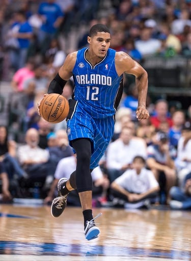 Oct 14, 2013; Dallas, TX, USA; Orlando Magic small forward Tobias Harris (12) brings the ball up court during the game against the Dallas Mavericks at the American Airlines Center. The Magic defeated the Mavericks 102-94. Mandatory Credit: Jerome Miron-USA TODAY Sports