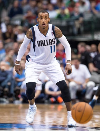 Oct 14, 2013; Dallas, TX, USA; Dallas Mavericks point guard Monta Ellis (11) defends against the Orlando Magic during the game at the American Airlines Center. The Magic defeated the Mavericks 102-94. Mandatory Credit: Jerome Miron-USA TODAY Sports