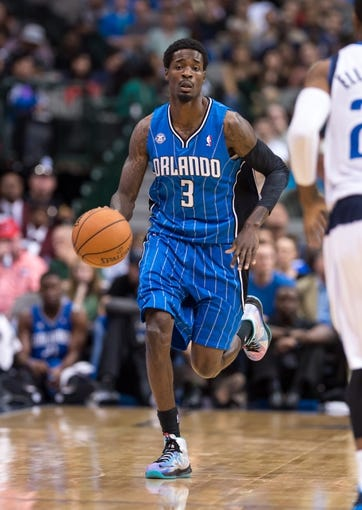 Oct 14, 2013; Dallas, TX, USA; Orlando Magic point guard Manny Harris (3) brings the ball up court during the game against the Dallas Mavericks at the American Airlines Center. The Magic defeated the Mavericks 102-94. Mandatory Credit: Jerome Miron-USA TODAY Sports