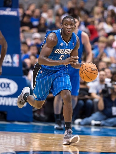 Oct 14, 2013; Dallas, TX, USA; Orlando Magic shooting guard Victor Oladipo (5) brings the ball up court during the game against the Dallas Mavericks at the American Airlines Center. The Magic defeated the Mavericks 102-94. Mandatory Credit: Jerome Miron-USA TODAY Sports