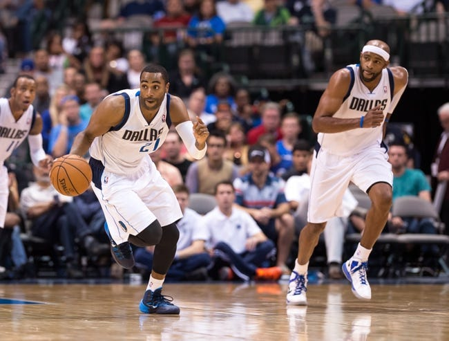 Oct 14, 2013; Dallas, TX, USA; Dallas Mavericks shooting guard Wayne Ellington (21) brings the ball up court during the game against the Orlando Magic at the American Airlines Center. The Magic defeated the Mavericks 102-94. Mandatory Credit: Jerome Miron-USA TODAY Sports