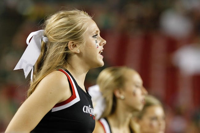 Oct 5, 2013; Tampa, FL, USA; Cincinnati Bearcats cheerleader cheers against the South Florida Bulls during the second half at Raymond James Stadium. South Florida Bulls defeated the Cincinnati Bearcats 26-20. Mandatory Credit: Kim Klement-USA TODAY Sports