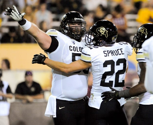Oct 12, 2013; Tempe, AZ, USA; Colorado Buffaloes wide receiver Nelson Spruce (22) and offensive lineman Gus Handler (55) celebrate after a touchdown during the second quarter against the Arizona State Sun Devils at Sun Devil Stadium. The Sun Devils beat the Buffaloes 54-13. Mandatory Credit: Casey Sapio-USA TODAY Sports