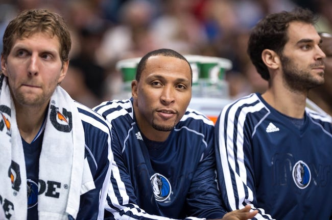 Oct 14, 2013; Dallas, TX, USA; Dallas Mavericks power forward Dirk Nowitzki (41) and small forward Shawn Marion (0) and point guard Jose Calderon (8) watch the game between the Mavericks and the Orlando Magic during the game at the American Airlines Center. The Magic defeated the Mavericks 102-94. Mandatory Credit: Jerome Miron-USA TODAY Sports