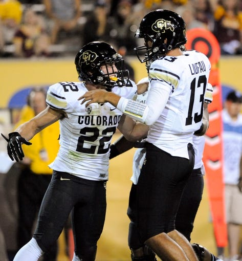 Oct 12, 2013; Tempe, AZ, USA; Colorado Buffaloes wide receiver Nelson Spruce (22) is congratulated by quarterback Sefo Liufau (13) after scoring a touchdown during the second quarter against the Arizona State Sun Devils at Sun Devil Stadium. The Sun Devils beat the Buffaloes 54-13. Mandatory Credit: Casey Sapio-USA TODAY Sports