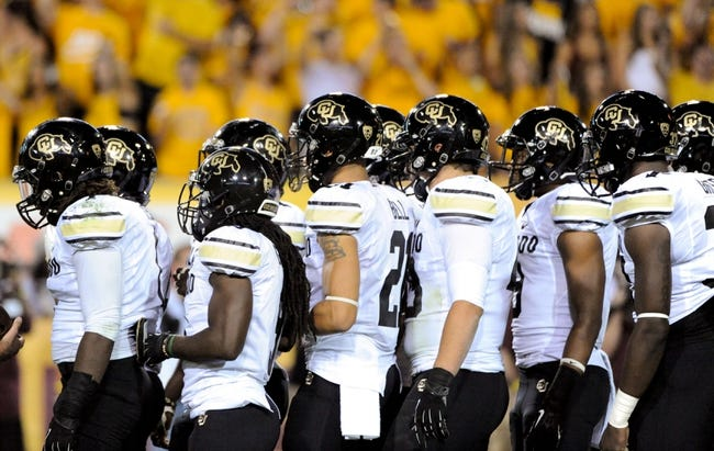 Oct 12, 2013; Tempe, AZ, USA; Colorado Buffaloes defensive back Jered Bell (21) and his teammates huddle up  during the second quarter against the Arizona State Sun Devils at Sun Devil Stadium. The Sun Devils beat the Buffaloes 54-13. Mandatory Credit: Casey Sapio-USA TODAY Sports