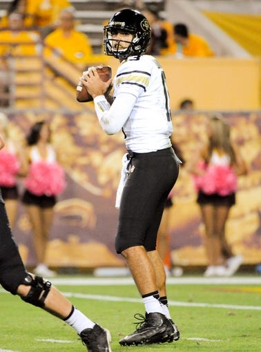 Oct 12, 2013; Tempe, AZ, USA; Colorado Buffaloes quarterback Sefo Liufau (13) looks for an open receiver to pass to during the fourth quarter against the Arizona State Sun Devils at Sun Devil Stadium. The Sun Devils beat the Buffaloes 54-13. Mandatory Credit: Casey Sapio-USA TODAY Sports