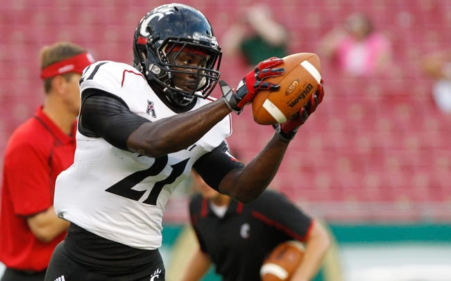 Oct 5, 2013; Tampa, FL, USA; Cincinnati Bearcats running back Rodriguez Moore (21) against the South Florida Bulls prior to the game at Raymond James Stadium. Mandatory Credit: Kim Klement-USA TODAY Sports