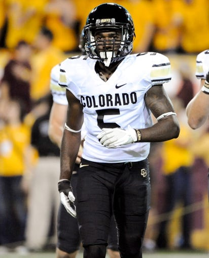 Oct 12, 2013; Tempe, AZ, USA; Colorado Buffaloes defensive back John Walker (5) in between plays during the second quarter against the Arizona State Sun Devils at Sun Devil Stadium. The Sun Devils beat the Buffaloes 54-13. Mandatory Credit: Casey Sapio-USA TODAY Sports