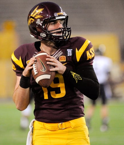 Oct 12, 2013; Tempe, AZ, USA; Arizona State Sun Devils quarterback Taylor Cohan (19) practices during warm ups before the first quarter against the Colorado Buffaloes at Sun Devil Stadium. The Sun Devils beat the Buffaloes 54-13. Mandatory Credit: Casey Sapio-USA TODAY Sports