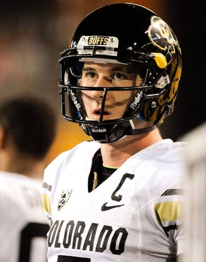 Oct 12, 2013; Tempe, AZ, USA; Colorado Buffaloes quarterback Connor Wood (5) watches from the sidelines  during the first quarter against the Arizona State Sun Devils at Sun Devil Stadium. The Sun Devils beat the Buffaloes 54-13. Mandatory Credit: Casey Sapio-USA TODAY Sports
