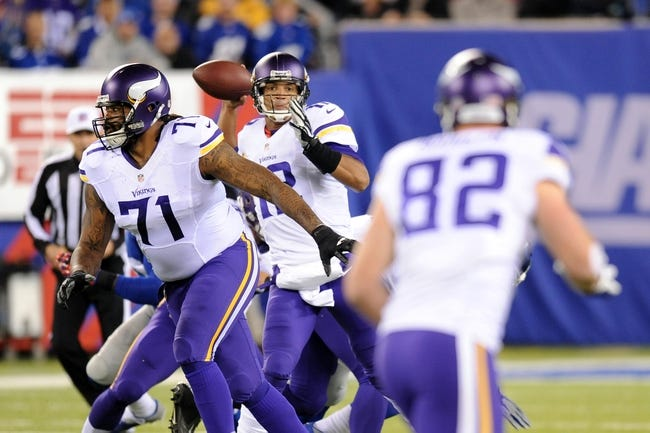 Oct 21, 2013; East Rutherford, NJ, USA; Minnesota Vikings quarterback Josh Freeman (12) throws a pass to tight end Kyle Rudolph (82) during the first half at MetLife Stadium. The Giants won the game 23-7. Mandatory Credit: Joe Camporeale-USA TODAY Sports