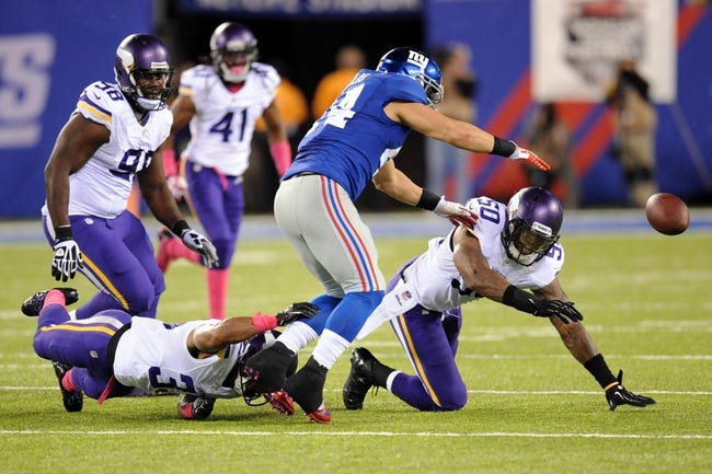 Oct 21, 2013; East Rutherford, NJ, USA; New York Giants running back Peyton Hillis (44) fumbles against the Minnesota Vikings during the first half at MetLife Stadium. The Giants won the game 23-7. Mandatory Credit: Joe Camporeale-USA TODAY Sports