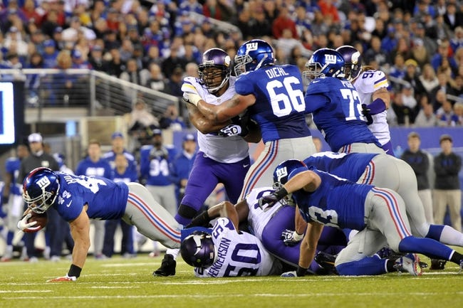 Oct 21, 2013; East Rutherford, NJ, USA; New York Giants running back Peyton Hillis (44) dives for extra yardage on a rush attempt against the Minnesota Vikings during the first half at MetLife Stadium. The Giants won the game 23-7. Mandatory Credit: Joe Camporeale-USA TODAY Sports