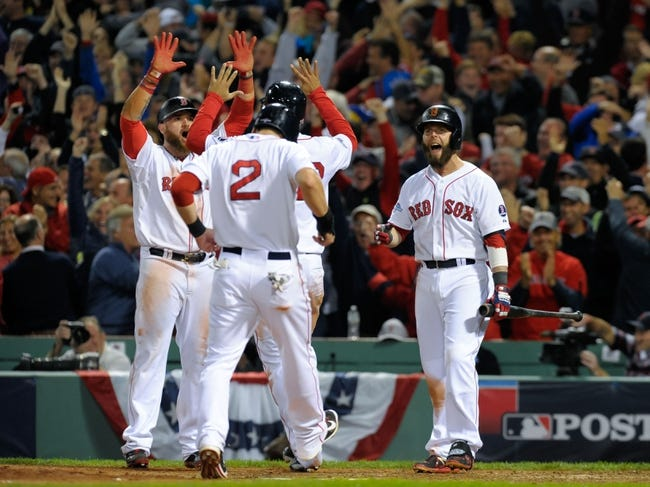 Oct 19, 2013; Boston, MA, USA; Boston Red Sox second baseman Dustin Pedroia (15) reacts after center fielder Jacoby Ellsbury (2) crosses the plate after scoring on a grand slam hit by right fielder Shane Victorino (not pictured) during the seventh inning in game six of the American League Championship Series baseball game against the Detroit Tigers at Fenway Park. Mandatory Credit: Bob DeChiara-USA TODAY Sports