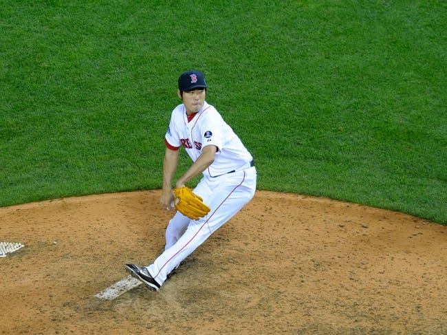 Oct 19, 2013; Boston, MA, USA; Boston Red Sox relief pitcher Koji Uehara (19) pitches during the ninth inning in game six of the American League Championship Series baseball game against the Detroit Tigers at Fenway Park. Mandatory Credit: Bob DeChiara-USA TODAY Sports