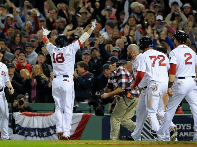 Oct 19, 2013; Boston, MA, USA; Boston Red Sox right fielder Shane Victorino (18) reacts to the fans after hitting a grand slam during the seventh inning in game six of the American League Championship Series baseball game against the Detroit Tigers at Fenway Park. Mandatory Credit: Bob DeChiara-USA TODAY Sports