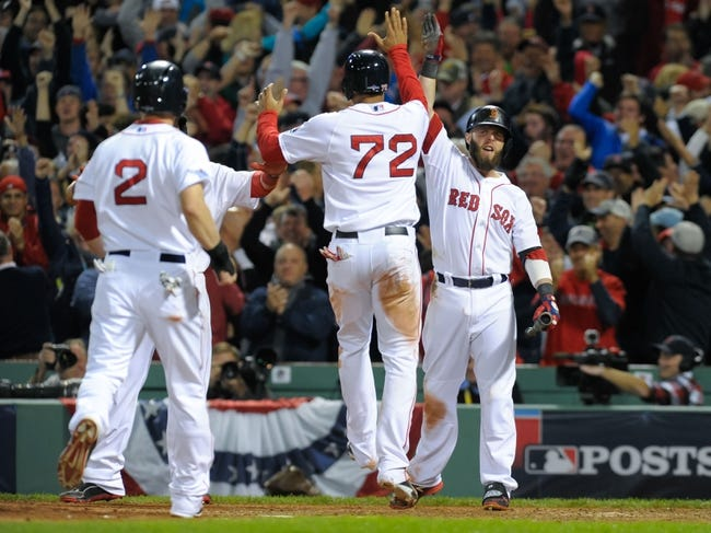 Oct 19, 2013; Boston, MA, USA; Boston Red Sox second baseman Dustin Pedroia (15) high fives shortstop Xander Bogaerts (72) after scoring on a grand slam hit by right fielder Shane Victorino (not pictured) during the seventh inning in game six of the American League Championship Series baseball game against the Detroit Tigers at Fenway Park. Mandatory Credit: Bob DeChiara-USA TODAY Sports