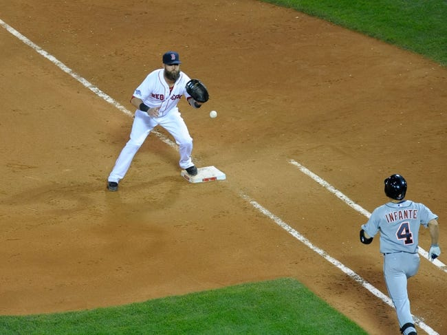 Oct 19, 2013; Boston, MA, USA; Boston Red Sox first baseman Mike Napoli (12) puts out Detroit Tigers second baseman Omar Infante (4) during the ninth inning in game six of the American League Championship Series baseball game at Fenway Park. Mandatory Credit: Bob DeChiara-USA TODAY Sports