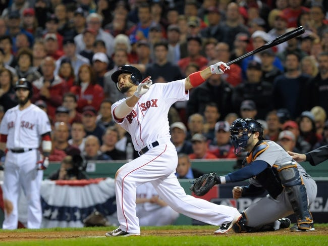 Oct 19, 2013; Boston, MA, USA; Boston Red Sox right fielder Shane Victorino (18) hits a grand slam during the seventh inning in game six of the American League Championship Series baseball game against the Detroit Tigers at Fenway Park. Mandatory Credit: Bob DeChiara-USA TODAY Sports