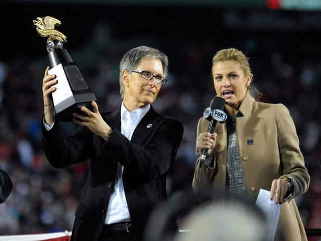 Oct 19, 2013; Boston, MA, USA; FOX reporter Erin Andrews with Boston Red Sox principal owner John Henry as he holds the American Legaue Championship trophy after defeating the Detroit Tigers in game six of the American League Championship Series baseball game at Fenway Park. Mandatory Credit: Bob DeChiara-USA TODAY Sports