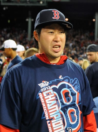 Oct 19, 2013; Boston, MA, USA; Boston Red Sox relief pitcher Junichi Tazawa (36) on the field after defeating the Detroit Tigers to win the pennant in game six of the American League Championship Series baseball game at Fenway Park. Mandatory Credit: Bob DeChiara-USA TODAY Sports