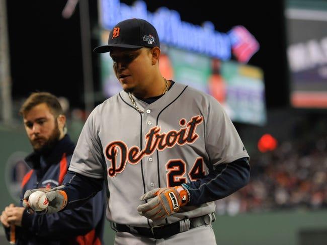 Oct 19, 2013; Boston, MA, USA; Detroit Tigers third baseman Miguel Cabrera (24) signs a baseball prior to game six of the American League Championship Series baseball game against the Boston Red Sox at Fenway Park. Mandatory Credit: Bob DeChiara-USA TODAY Sports