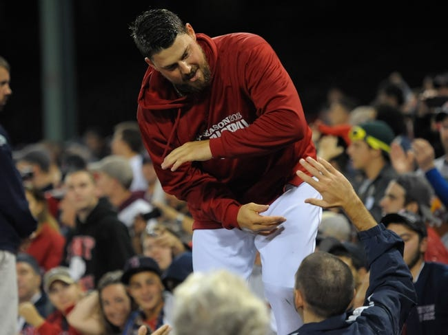 Oct 19, 2013; Boston, MA, USA; Boston Red Sox catcher Ryan Lavarnway is congratulated by a fan after defeating the Detroit Tigers in game six of the American League Championship Series baseball game at Fenway Park. Mandatory Credit: Bob DeChiara-USA TODAY Sports