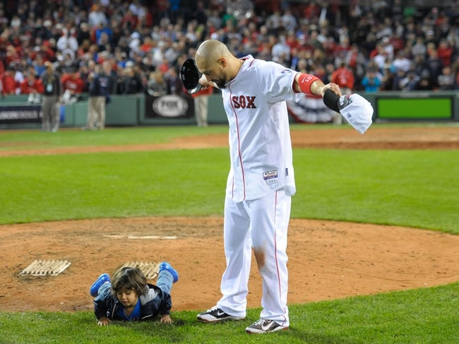 Oct 19, 2013; Boston, MA, USA; Boston Red Sox right fielder Shane Victorino (18) with his son Kingston Victorino after defeating the Detroit Tigers in game six of the American League Championship Series baseball game at Fenway Park. Mandatory Credit: Bob DeChiara-USA TODAY Sports