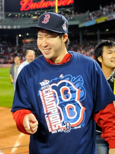 Oct 19, 2013; Boston, MA, USA; Boston Red Sox relief pitcher Junichi Tazawa (36) after defeating the Detroit Tigers in game six of the American League Championship Series baseball game at Fenway Park. Mandatory Credit: Bob DeChiara-USA TODAY Sports