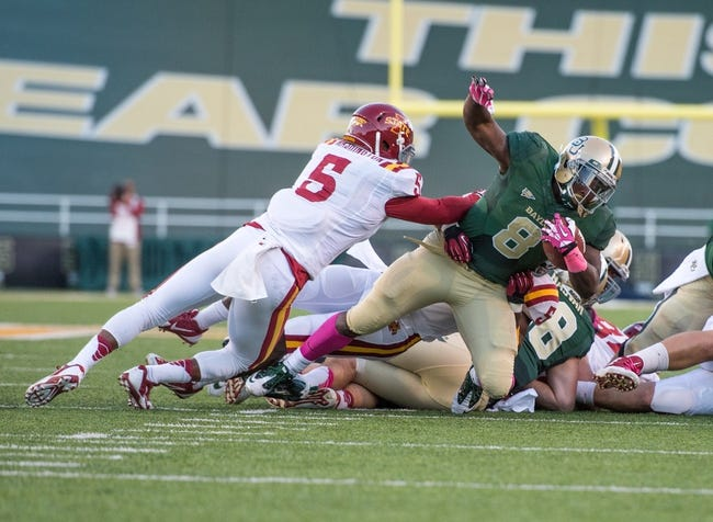 Oct 19, 2013; Waco, TX, USA; Baylor Bears running back Glasco Martin (8) dives past Iowa State Cyclones defensive back Jacques Washington (5) during the game at Floyd Casey Stadium. The Bears defeated the Cyclones 71-7. Mandatory Credit: Jerome Miron-USA TODAY Sports