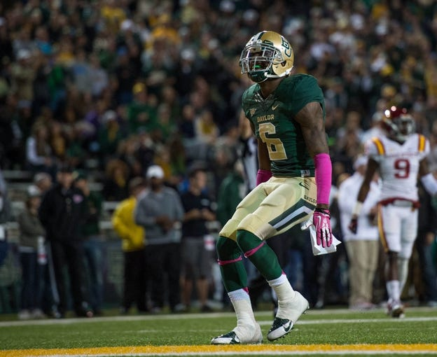 Oct 19, 2013; Waco, TX, USA; Baylor Bears safety Ahmad Dixon (6) celebrates a defensive stop against the Iowa State Cyclones during the game at Floyd Casey Stadium. The Bears defeated the Cyclones 71-7. Mandatory Credit: Jerome Miron-USA TODAY Sports
