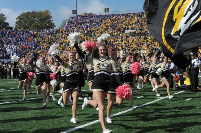 Oct 19, 2013; Columbia, MO, USA; Missouri Tigers cheerleaders run onto the field before the game against the Florida Gators at Faurot Field. Missouri won 36-17. Mandatory Credit: Denny Medley-USA TODAY Sports