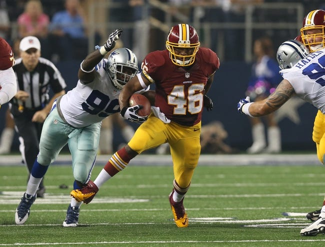 Oct 13, 2013; Arlington, TX, USA; Washington Redskins running back Alfred Morris (46) runs with the ball against Dallas Cowboys defensive end George Selvie (99) at AT&T Stadium. Mandatory Credit: Matthew Emmons-USA TODAY Sports
