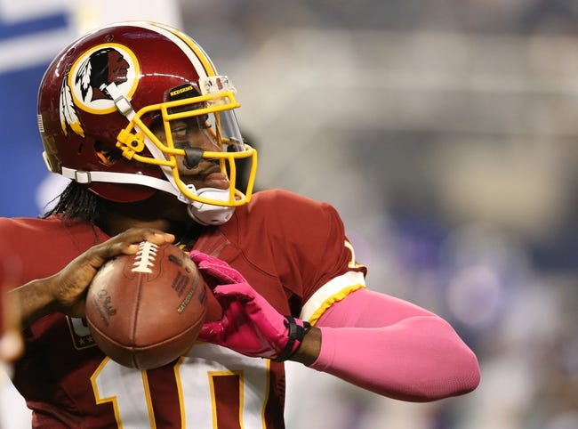 Oct 13, 2013; Arlington, TX, USA; Washington Redskins quarterback Robert Griffin III (10) throws prior to the game against the Dallas Cowboys at AT&T Stadium. Mandatory Credit: Matthew Emmons-USA TODAY Sports