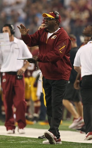 Oct 13, 2013; Arlington, TX, USA; Washington Redskins assistant head coach Bobby Turner reacts on the sidelines during the game against the Dallas Cowboys at AT&T Stadium. Mandatory Credit: Matthew Emmons-USA TODAY Sports