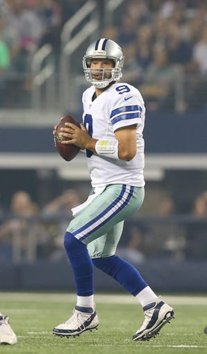 Oct 13, 2013; Arlington, TX, USA; Dallas Cowboys quarterback Tony Romo (9) throws in the pocket against the Washington Redskins at AT&T Stadium. Mandatory Credit: Matthew Emmons-USA TODAY Sports